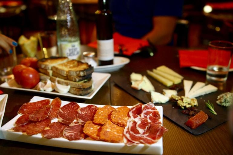 Savor Spain barcelona food and history tour spanish meat and cheese platter