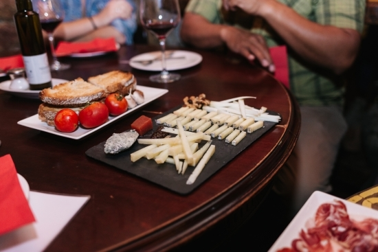 Tasting delicious cheese on a private cheese and wine pairing tour in barcelona with wanderbeak