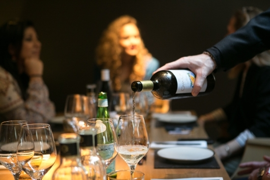 Tasting delicious wines on a private cheese and wine pairing tour in barcelona with wanderbeak