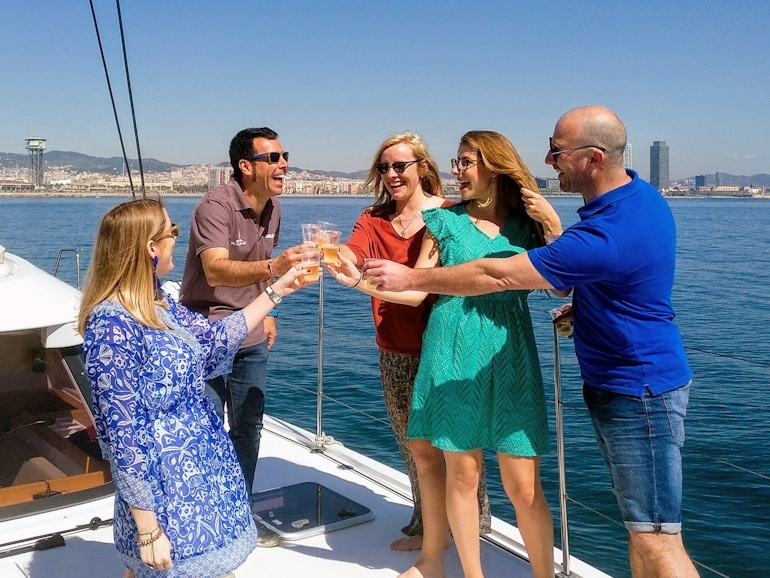 a happy group of friends celebrating on a barcelona sailing experience with wanderbeak tours barcelona