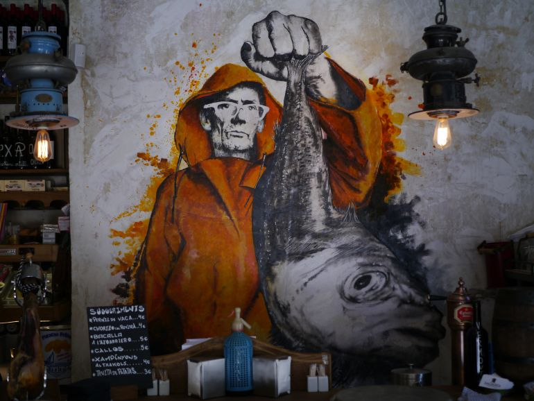 bodega fisherman art on a Wanderbeak Tours Tapas and wine tour