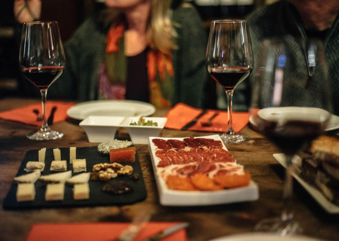 We Heart bloggers in a 16th Century Bodega eating & drinking on a wanderbeak savor spain food tour barcelona